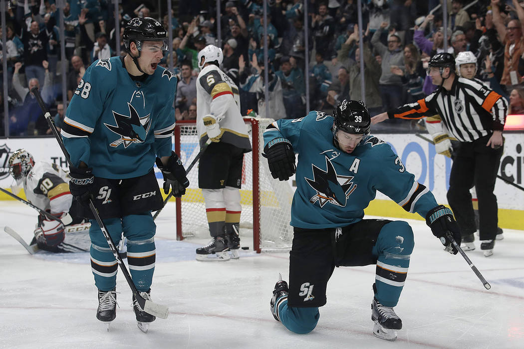 San Jose Sharks center Logan Couture, right, celebrates with right wing Timo Meier (28) after scoring a goal against the Vegas Golden Knights during the first period of an NHL hockey game in San J ...