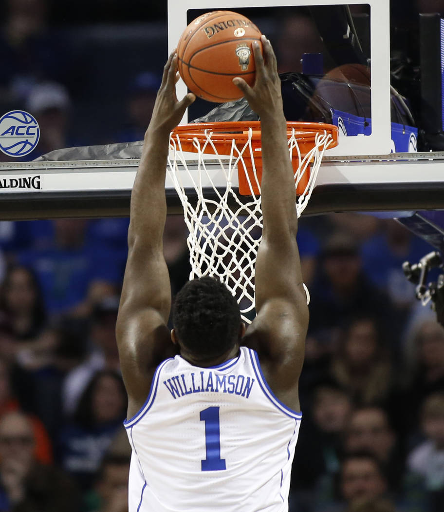 Zion Williamson (1) goes up to dunk against Florida State during the first half of the NCAA college basketball championship game of the Atlantic Coast Conference tournament in Charlotte, N.C., Sat ...