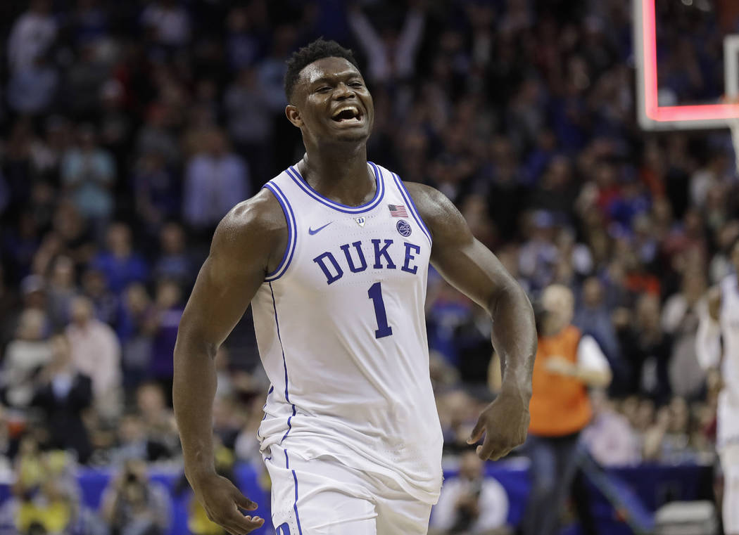 Duke's Zion Williamson (1) celebrates after Duke defeated Florida State in the NCAA college basketball championship game of the Atlantic Coast Conference tournament in Charlotte, N.C., Saturday, M ...