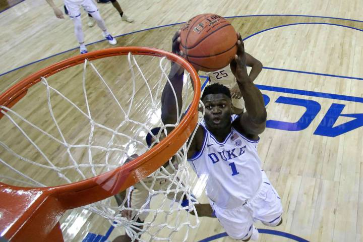 Duke's Zion Williamson (1) goes up to dunk against Florida State during the first half of the NCAA college basketball championship game of the Atlantic Coast Conference tournament in Charlotte, N. ...