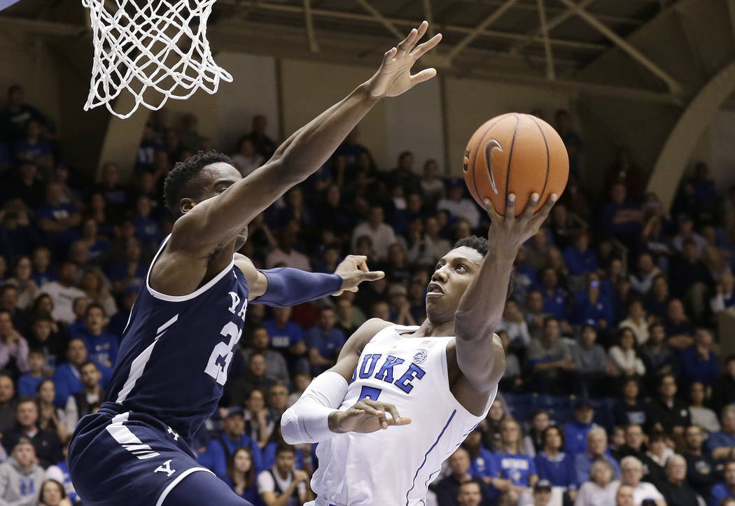 Duke's RJ Barrett shoots while Yale's Miye Oni defends during the second half of an NCAA college basketball game in Durham, N.C., Saturday, Dec. 8, 2018. Duke won 91-58. (AP Photo/Gerry Broome)