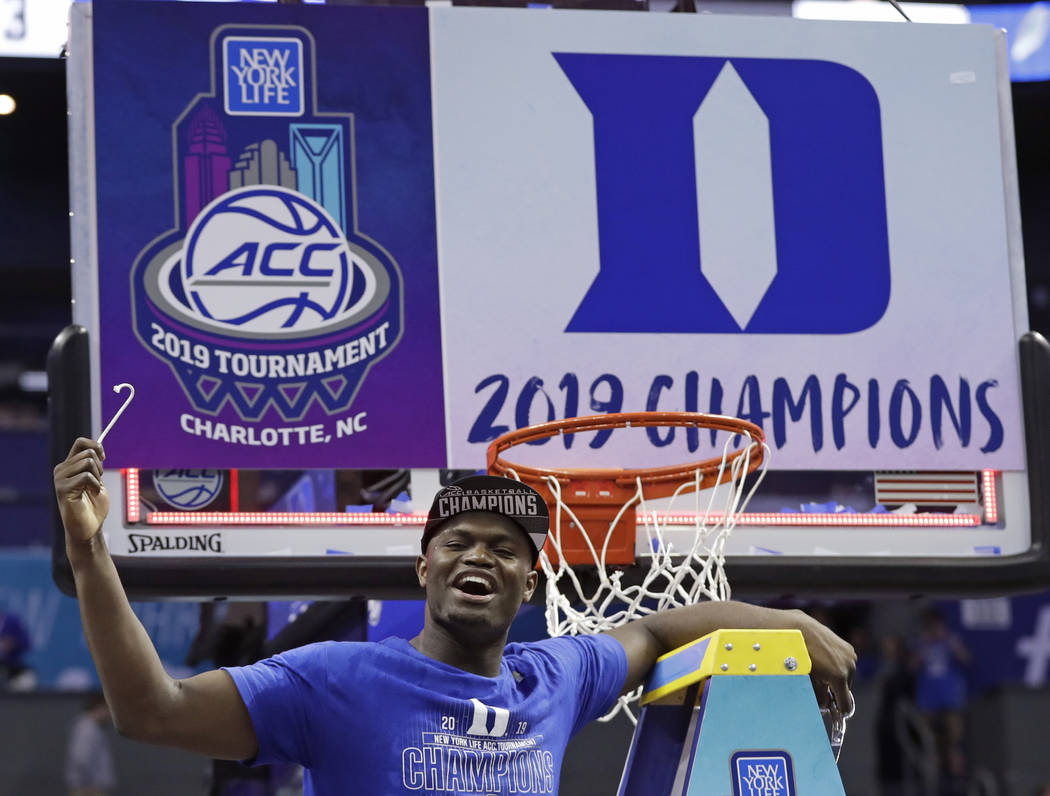 Duke's Zion Williamson celebrates Duke's win over Florida State after cutting a piece of a net after the NCAA college basketball championship game of the Atlantic Coast Conference tournament in Ch ...