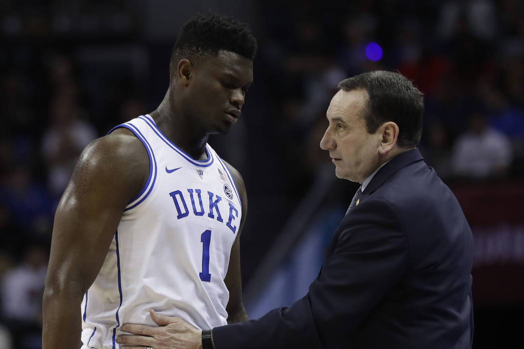 Duke head coach Mike Krzyzewski talks to Zion Williamson (1) during the first half of the NCAA college basketball championship game of the Atlantic Coast Conference tournament in Charlotte, N.C., ...