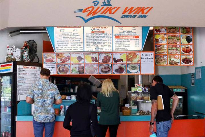 In this Thursday, March 14, 2019 photo, customers line up at the Wiki Wiki Drive Inn takeout restaurant counter in Honolulu. Hawaii would be the first state in the nation to ban most plastics used ...