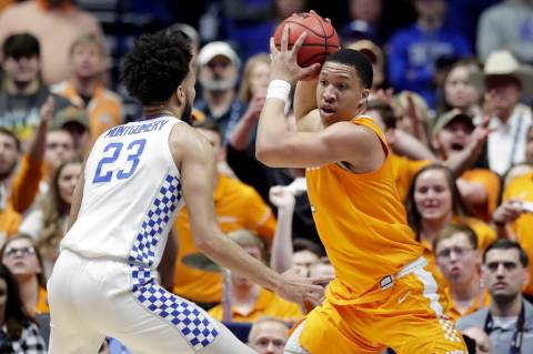 Tennessee's Grant Williams, right, protects the ball from Kentucky forward EJ Montgomery (23) in the first half of an NCAA college basketball game at the Southeastern Conference tournament Saturda ...