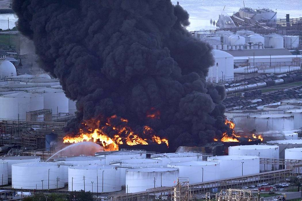 Firefighters battle a petrochemical fire at the Intercontinental Terminals Company Monday, March 18, 2019, in Deer Park, Texas. The large fire at a Houston-area petrochemicals terminal will likely ...