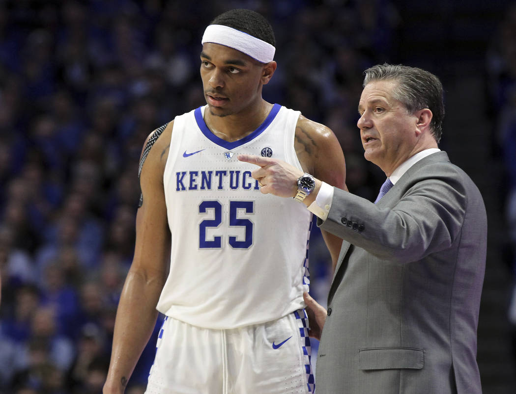 Kentucky head coach John Calipari, right, instructs PJ Washington (25) during the second half of an NCAA college basketball game against Florida in Lexington, Ky., Saturday, March 9, 2019. Kentuck ...