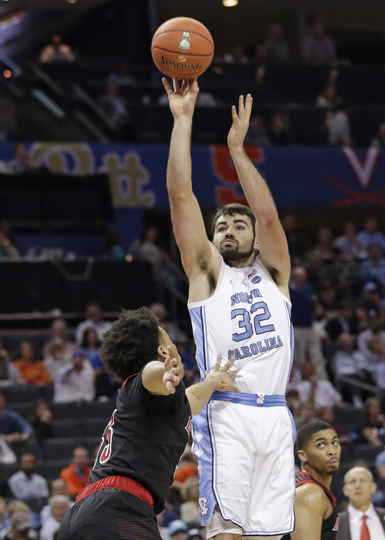 North Carolina's Luke Maye (32) shots over Louisville's Jordan Nwora (33) during the first half of an NCAA college basketball game in the Atlantic Coast Conference tournament in Charlotte, N.C., T ...
