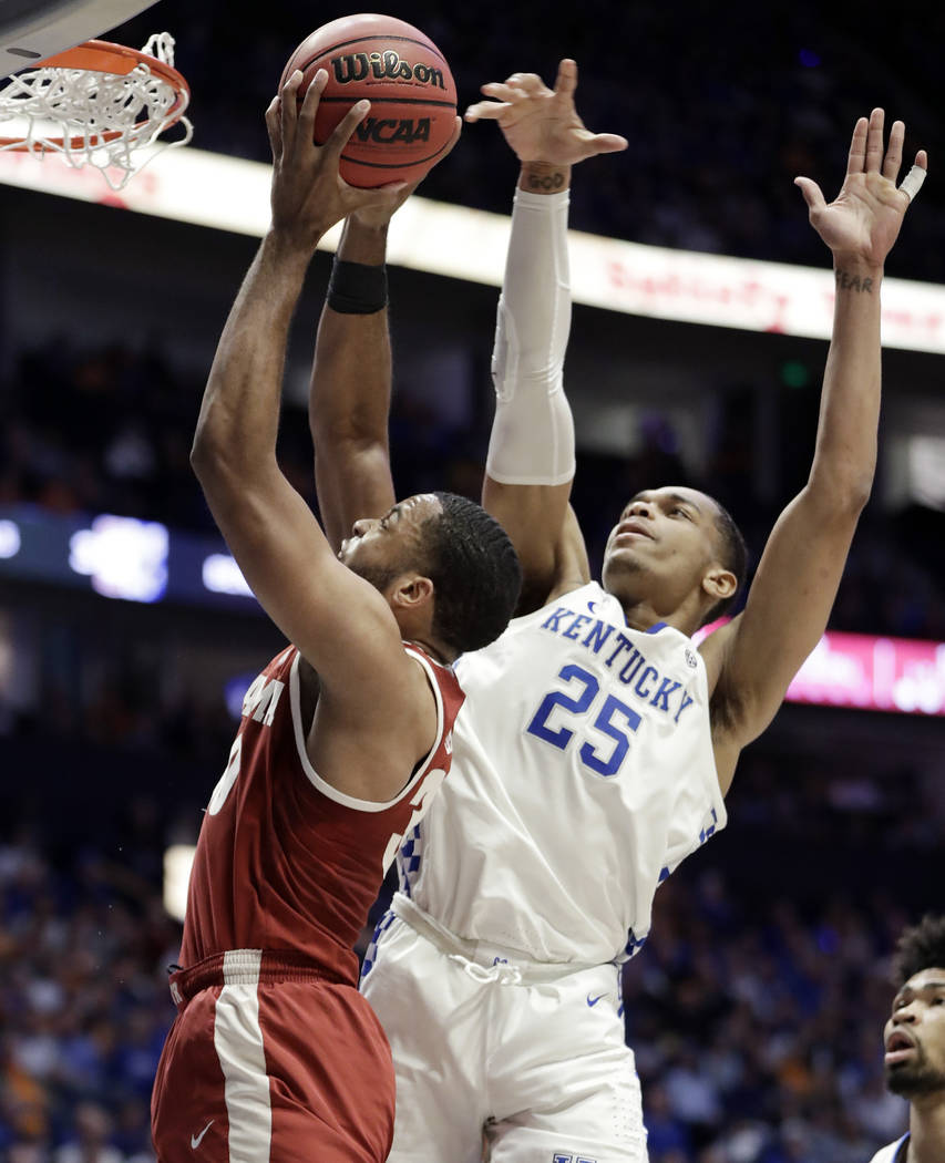 Alabama forward Galin Smith (30) shoots as he is defended by Kentucky forward PJ Washington (25) in the first half of an NCAA college basketball game at the Southeastern Conference tournament Frid ...