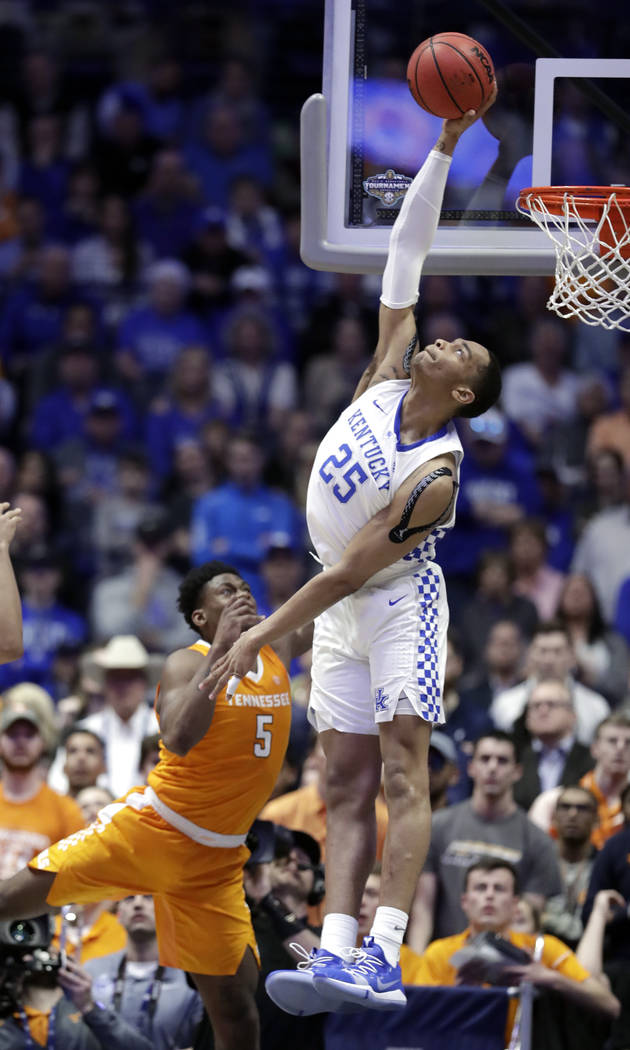 Kentucky forward PJ Washington (25) blocks a shot by Tennessee guard Admiral Schofield (5) but was called for goaltending in the second half of an NCAA college basketball game at the Southeastern ...