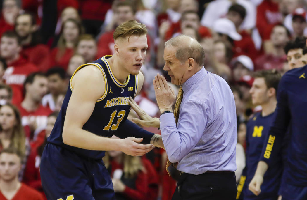 Michigan head coach John Beilein and Ignas Brazdeikis during the second half of an NCAA college basketball game Saturday, Jan. 19, 2019, in Madison, Wis. Wisconsin upset Michigan 64-54. (AP Photo/ ...