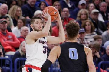 Gonzaga forward Killian Tillie, left, looks to pass in front of San Diego forward Isaiah Pineiro (0) during the second half of an NCAA college basketball game in Spokane, Wash., Saturday, Feb. 2, ...