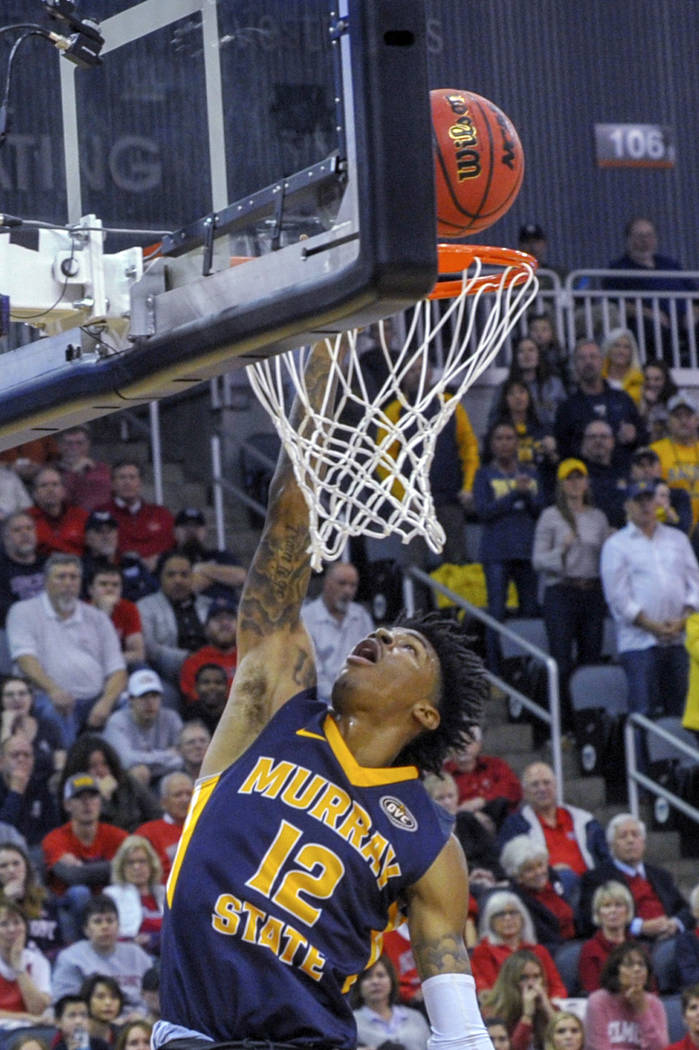 Murray State's Ja Morant (12) goes up for a slam dunk during the first half of an NCAA college basketball game in the championship of the Ohio Valley Conference basketball tournament, Saturday, Ma ...