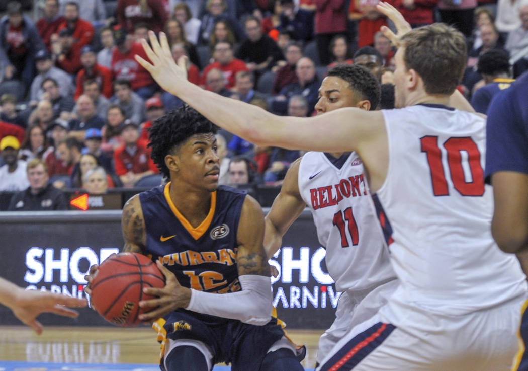 Murray State's Ja Morant (12) looks for an opening as Belmont's Kevin McClain (11) and Caleb Hollnder (10) defend during the second half of an NCAA college basketball game for the championship of ...