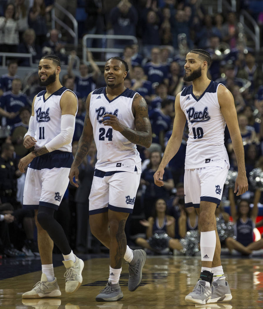 Nevada seniors Cody Martin (11), Jordan Caroline (24) and Caleb Martin (10) come off the floor at Lawlor Events Center for the last time at the end of their NCAA college basketball game against Sa ...