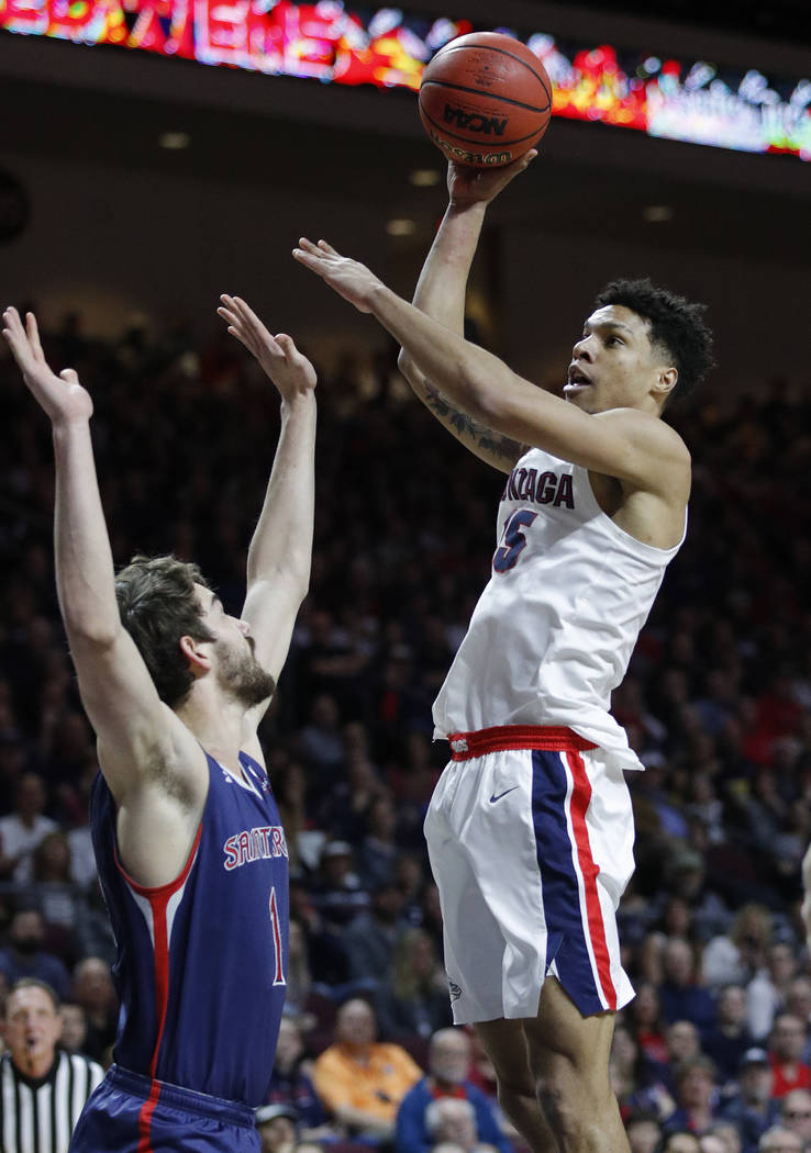 Gonzaga's Brandon Clarke shoots over St. Mary's Jordan Hunter during the first half of an NCAA college basketball game for the West Coast Conference men's tournament title, Tuesday, March 12, 2019 ...