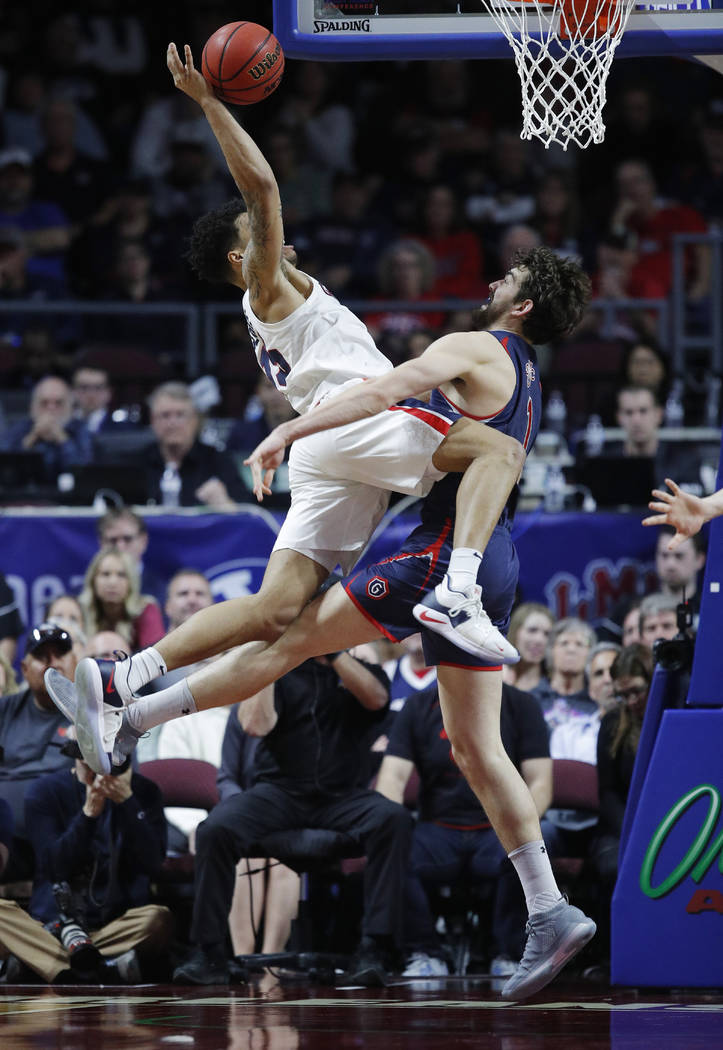St. Mary's Jordan Hunter, right, fouls Gonzaga's Brandon Clarke during the second half of an NCAA college basketball game for the West Coast Conference men's tournament title Tuesday, March 12, 20 ...