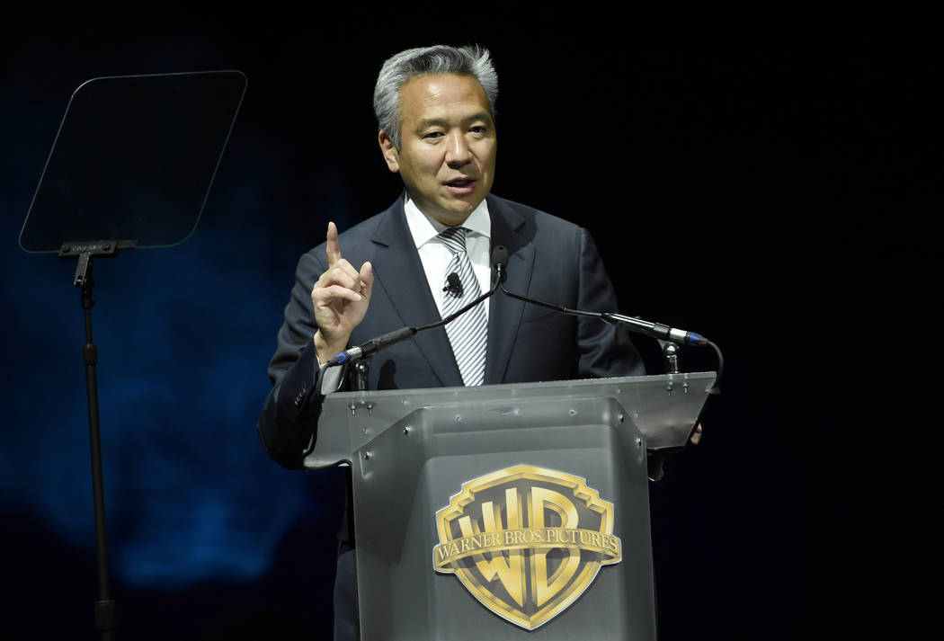 Kevin Tsujihara, chairman and CEO of Warner Bros., during the Warner Bros. presentation at CinemaCon 2015 in Las Vegas, April 21, 2015. Tsujihara is stepping down after claims that he promised act ...