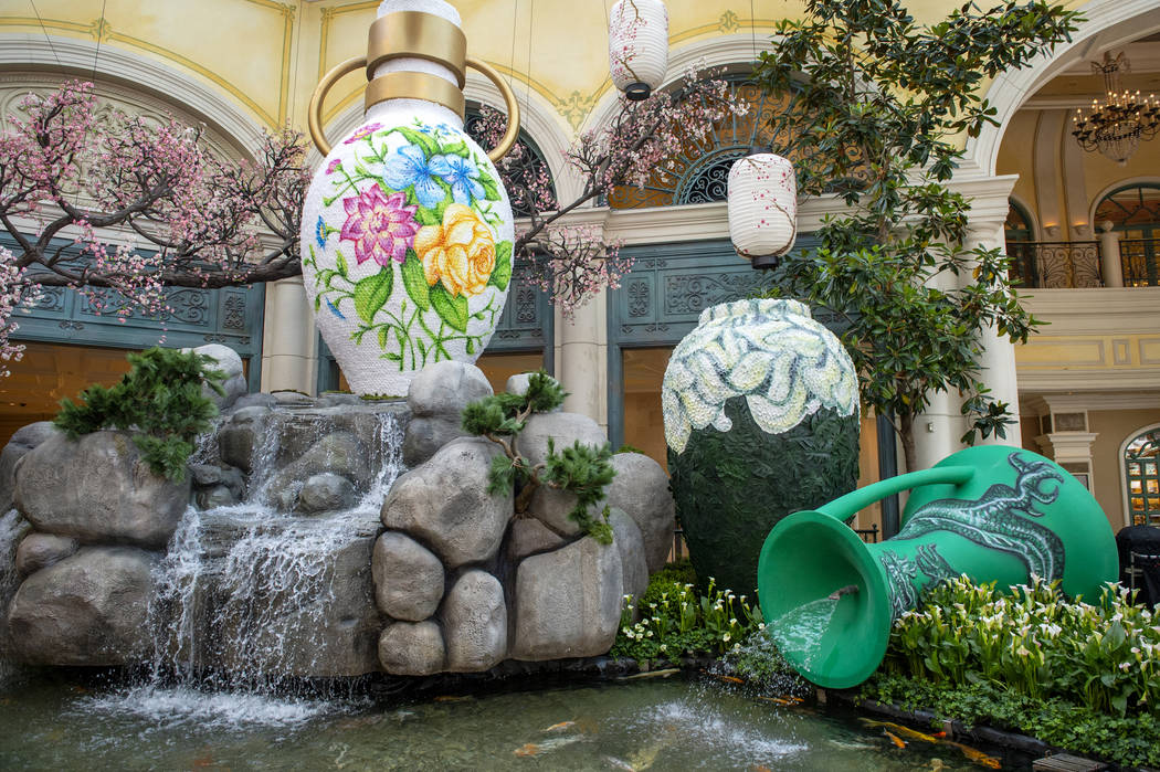 Japanese floral vases embellished with thousands of rose petals are showcased as a part of the Bellagio's spring display at the Bellagio Conservatory & Botanical Gardens in Las Vegas, Monday, ...