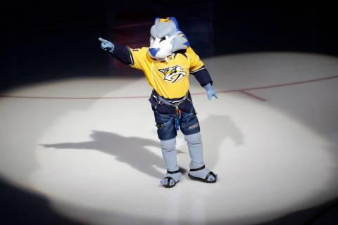 Gnash, the Nashville Predators' mascot, performs before an NHL hockey game between the Predators and the New York Rangers Saturday, Feb. 7, 2015, in Nashville, Tenn. (AP Photo/Mark Humphrey)