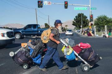 A man carries his possessions across North Las Vegas Boulevard and East Owens Avenue on Thursday, May 3, 2018, in Las Vegas. Benjamin Hager Las Vegas Review-Journal @benjaminhphoto