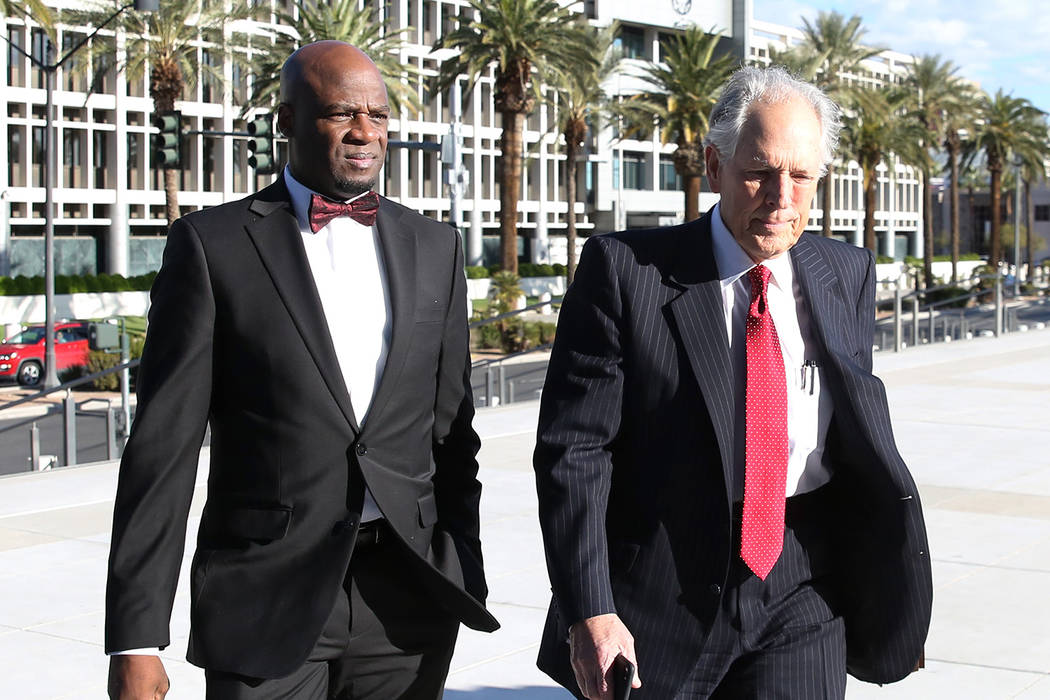 Former Nevada Senate majority leader Kelvin Atkinson, left, and his attorney Richard Wright arrive at the Lloyd George U.S. Courthouse on Monday, March. 11, 2019, in Las Vegas. Bizuayehu Tesfaye L ...