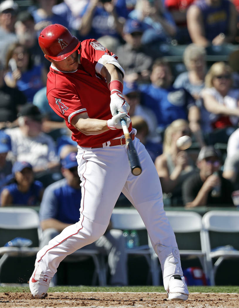 Los Angeles Angels' Mike Trout connects on a three-run home run against the Chicago Cubs in the third inning of a spring training baseball game Tuesday, March 5, 2019, in Tempe, Ariz. (AP Photo/El ...