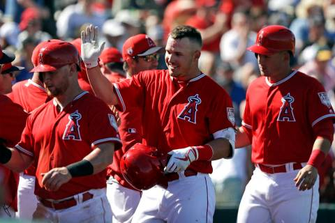 Los Angeles Angels' Mike Trout, center, is congratulated on his three-run home run against the Chicago Cubs in the third inning of a spring training baseball game Tuesday, March 5, 2019, in Tempe, ...