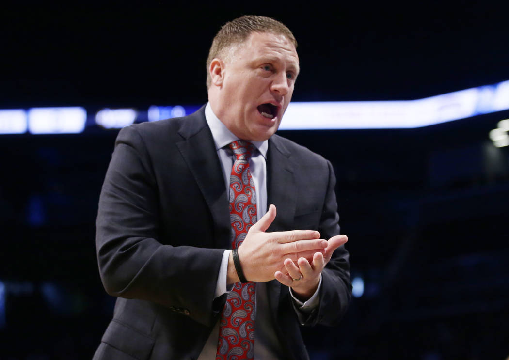 Virginia Commonwealth head coach Mike Rhoades talks to his team during the first half of an NCAA college basketball game against the St. John's in the championship round of the Legends Classic tou ...