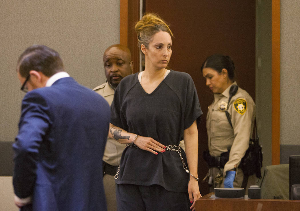 Attorney Alexis Plunkett enters the courtroom at the Regional Justice Center in Las Vegas on Tuesday, March 19, 2019. She pleaded guilty to allowing clients to use cellphones in jail. (Rachel Asto ...