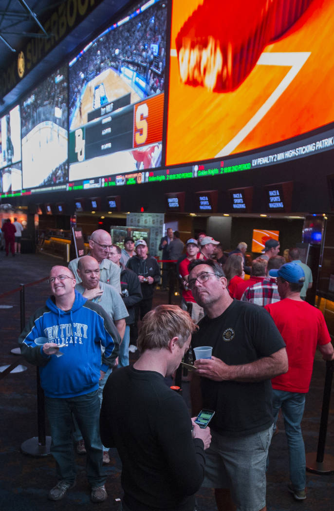 Basketball fans take in the first day of the NCAA Tournament at the Westgate Sportsbook on Thursday, March 21, 2019, at Westgate, in Las Vegas. (Benjamin Hager Review-Journal) @BenjaminHphoto