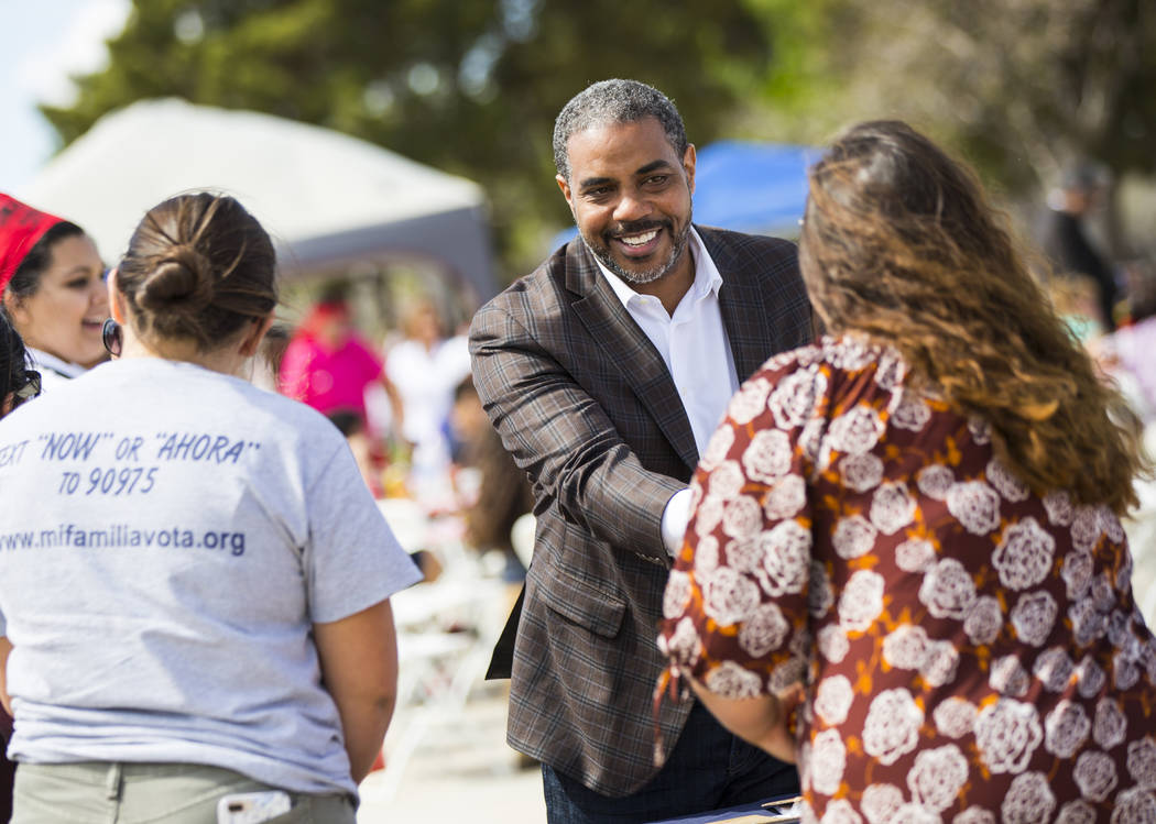 U.S. Rep. Steven Horsford, D-Nev., greets volunteers at the Mi Familia Vota booth during the Cesar Chavez Day festival at Freedom Park in Las Vegas on Saturday, March 23, 2019. (Chase Stevens/Las ...