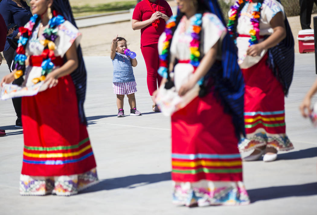 Two-year-old Sophia Medina dances along as to the Mexico Vivo dance company during the Cesar Chavez Day festival at Freedom Park in Las Vegas on Saturday, March 23, 2019. (Chase Stevens/Las Vegas ...