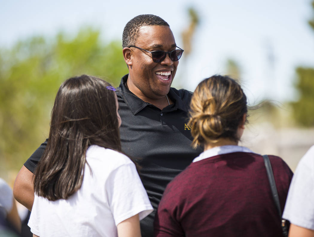 Las Vegas City Councilman Cedric Crear talks with volunteers at the Mi Familia Vota booth during the Cesar Chavez Day festival at Freedom Park in Las Vegas on Saturday, March 23, 2019. (Chase Stev ...