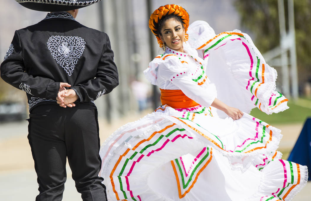 Shadaie Martinez, 17, of the Mexico Vivo dance company, right, performs with Gilberto Rodriguez, 14, during the Cesar Chavez Day festival at Freedom Park in Las Vegas on Saturday, March 23, 2019. ...