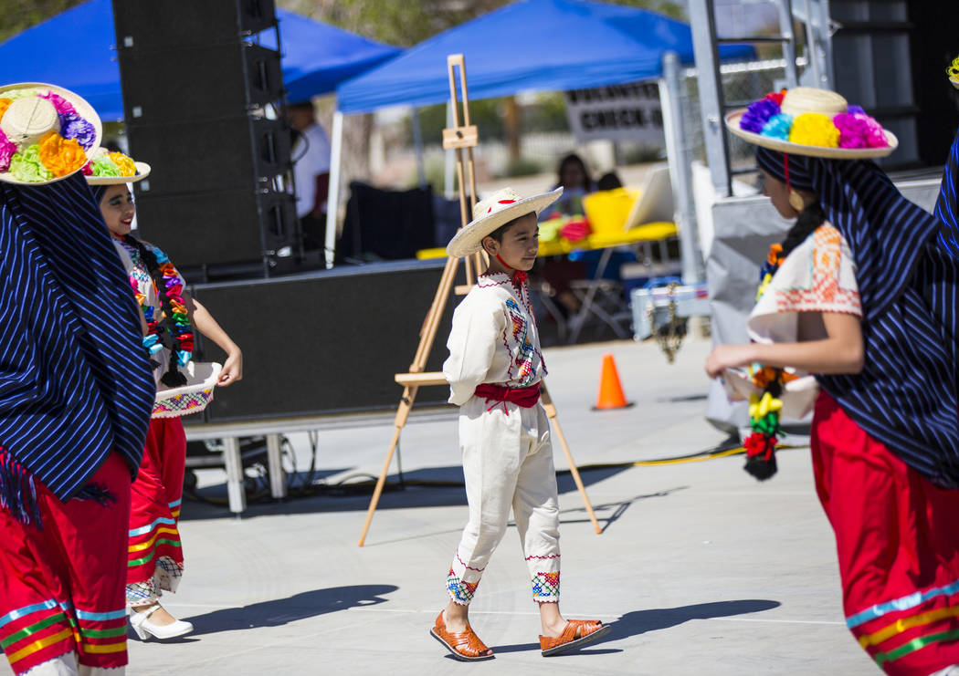Marcus Tapia, 9, of the Mexico Vivo dance company, performs as part of a folklorico dance during the Cesar Chavez Day festival at Freedom Park in Las Vegas on Saturday, March 23, 2019. (Chase Stev ...