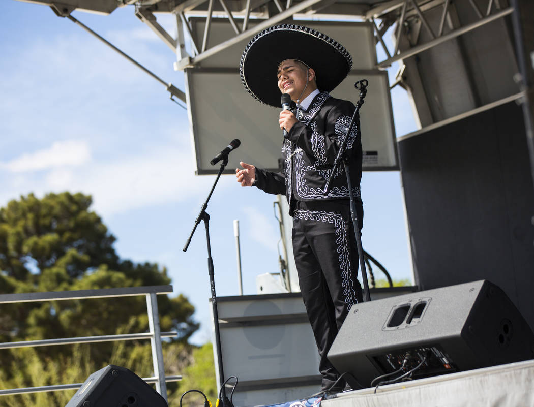 Gilberto Rodriguez, 14, of Las Vegas, sings during the Cesar Chavez Day festival at Freedom Park in Las Vegas on Saturday, March 23, 2019. (Chase Stevens/Las Vegas Review-Journal) @csstevensphoto