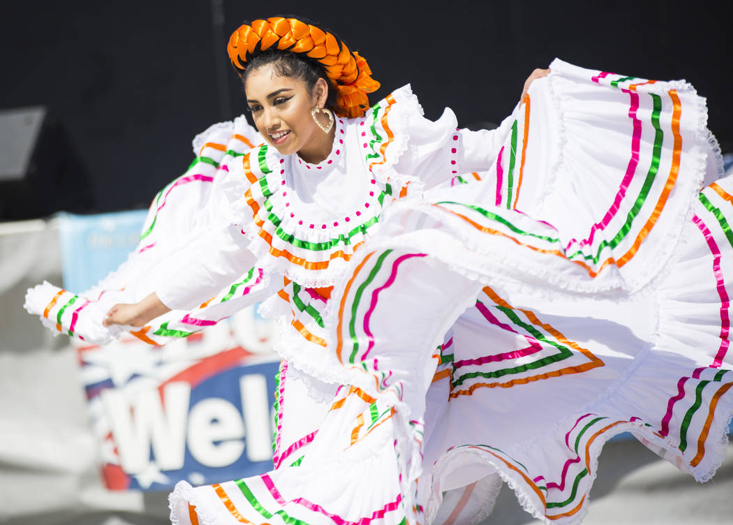 Shadaie Martinez, 17, of the Mexico Vivo dance company, performs during the Cesar Chavez Day festival at Freedom Park in Las Vegas on Saturday, March 23, 2019. (Chase Stevens/Las Vegas Review-Jour ...