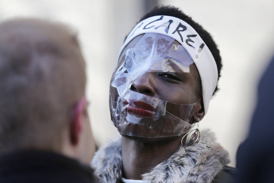 Therese Okoumou poses for pictures and rallies with supporters before her sentencing in New York, Tuesday, March 19, 2019. Okoumou was convicted of trespassing and other offenses after she climbed ...