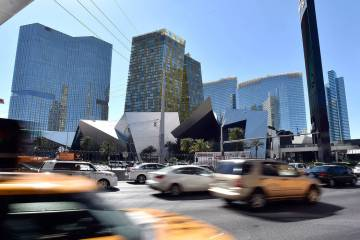 Vehicle traffic passes by the Shops at Crystals at CityCenter is seen Friday, March 18, 2016, in Las Vegas. MGM Resorts International entered into an agreement to sell the 324,000 square-foot Stri ...