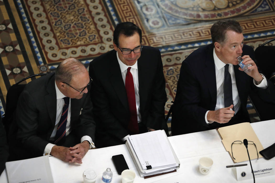 FILE- In this Feb. 21, 2019, file photo White House economic adviser Larry Kudlow, left, Treasury Secretary Steve Mnuchin, and U.S. Trade Representative Robert Lighthizer, attend a meeting of seni ...