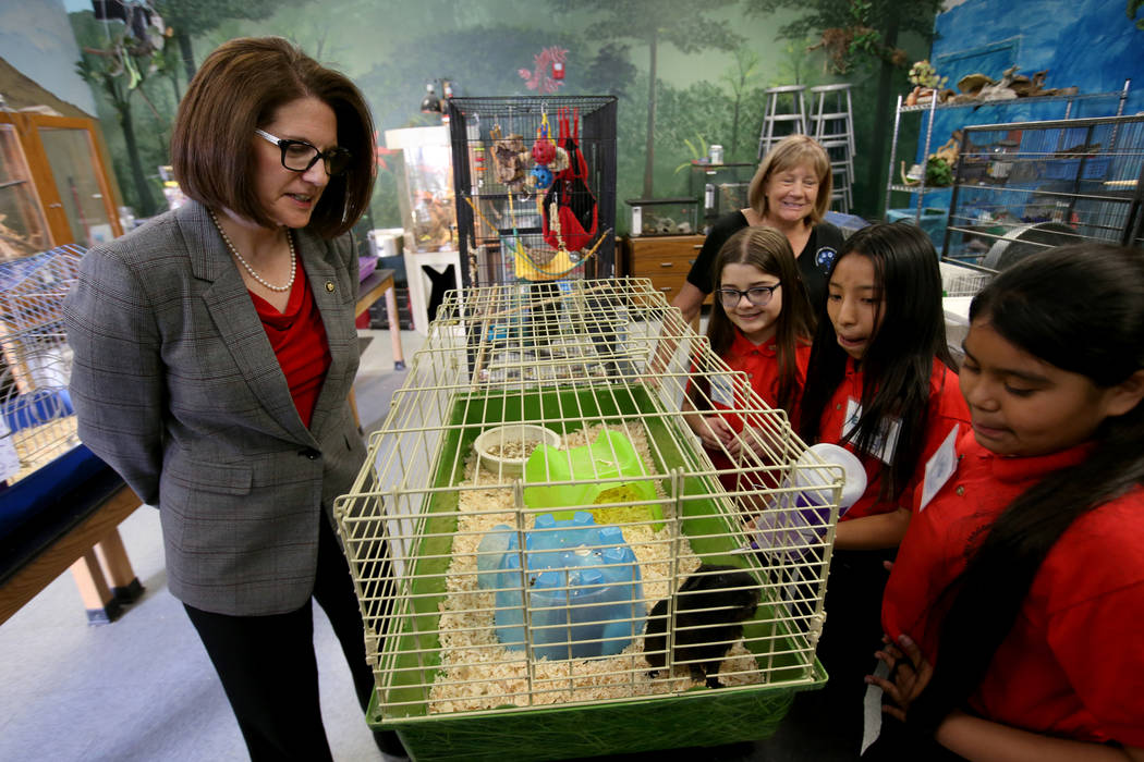 Hoggard Elementary fourth grade students, from left, Alannah Gruner, Emely San Juan and Iris Hernandez, all 10, and Life Science teacher Kim Law, rear, give a tour to Sen. Catherine Cortez Masto, ...