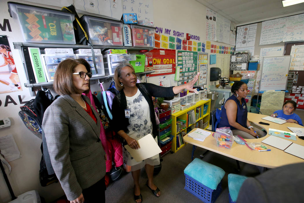 Hoggard Elementary principal Stacey Scott-Cherry, second from left, gives a tour to Sen. Catherine Cortez Masto, D-Nev., as first grade teacher Michelle Taylor works with student Vanessa Roman Tue ...