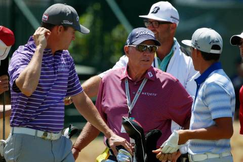 Golf instructor Butch Harmon, middle, talks with Jimmy Walker, left, and Rickie Fowler on the 18th hole during a practice round for the U.S. Open golf tournament at Chambers Bay on Tuesday, June 1 ...
