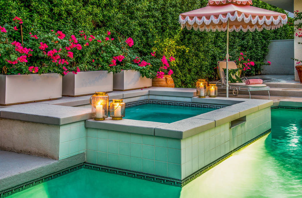 The pool area has a spa and lush landscaping. (Berkshire Hathaway HomeServices California Properties)