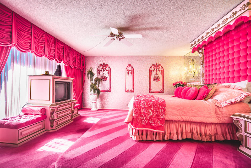 """The master bedroom is the """"pink room,"""" and was inspired by one of Elvis Presley's favorite colors. (Berkshire Hathaway HomeServices California Properties)"""