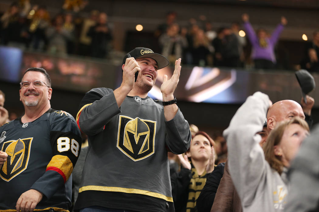 Fans celebrate a score by Vegas Golden Knights left wing Max Pacioretty (67) against Nashville Predators during the first period of an NHL hockey game at T-Mobile Arena in Las Vegas, Saturday, Feb ...