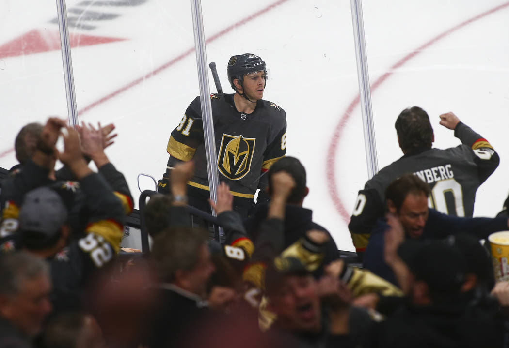 Fans celebrate a goal by Golden Knights center Jonathan Marchessault (81) during the third period of an NHL hockey game against the Winnipeg Jets at T-Mobile Arena in Las Vegas on Friday, Feb. 22, ...