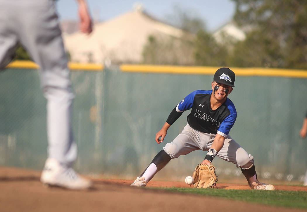 Basic's Dominik Tavares (5) catches a ground ball in the fourth inning of a baseball game at Liberty High School in Henderson, Tuesday, March 19, 2019. (Caroline Brehman/Las Vegas Review-Journal) ...