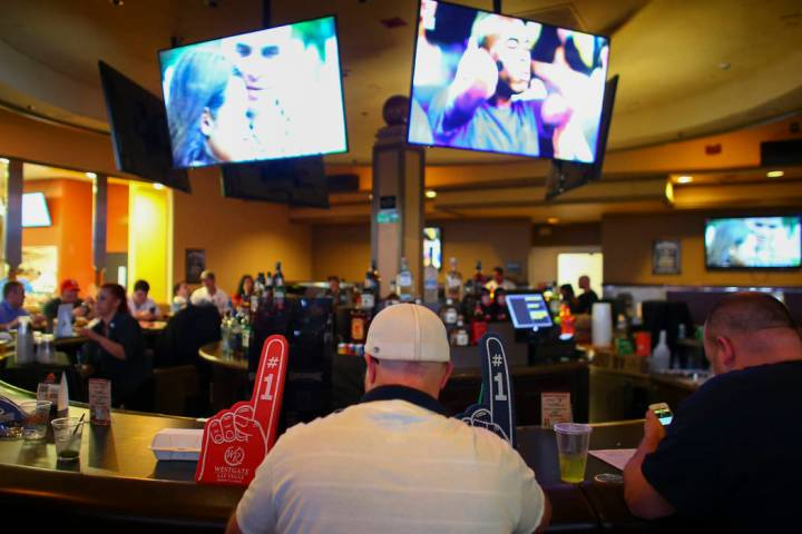 Basketball fans gather around a bar at the Westgate sports book during the first day of the NCAA basketball tournament in Las Vegas on Thursday, March 16, 2017. (Chase Stevens/Las Vegas Review-Jou ...